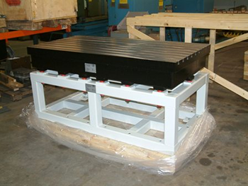 Steel T-slot Table on a heavy support frame with a first natural frequency  >100 Hz size approx. 1800 x 900 x 800 mm